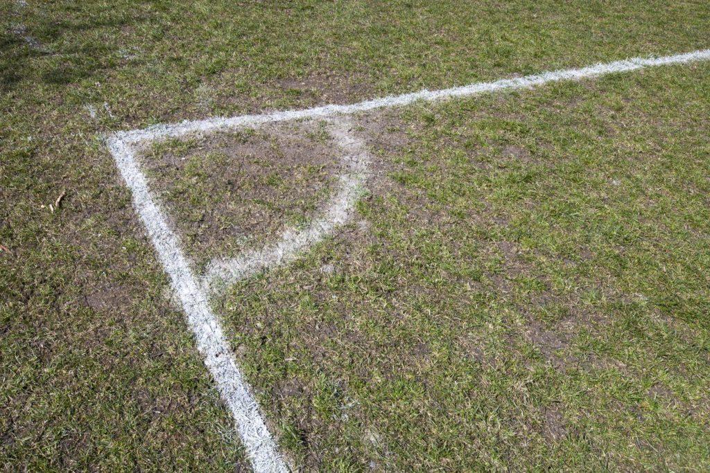 football pitch corner grass worn